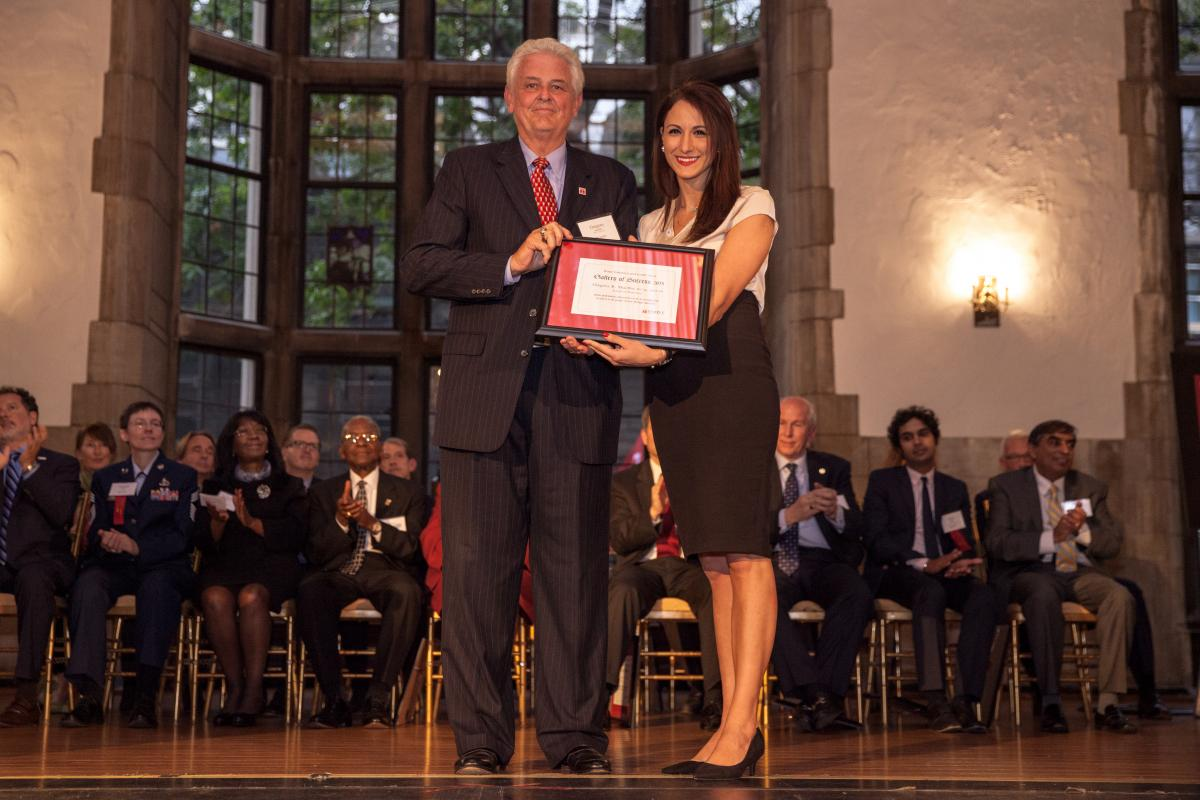 Jola Salavaci '17 presents alumnus Gregory Schaeffer, BS '74, MBA '99 with the 2015 Gallery of Success Award.